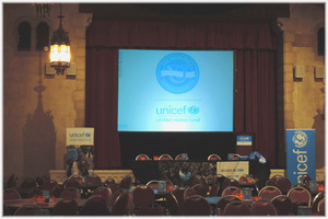 Stage podium for UNICEF conference at West Side Church